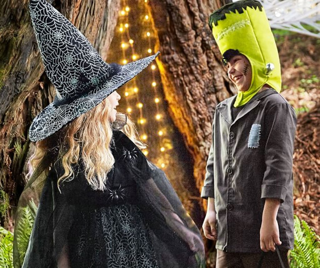 kids dressed up in spider witch and Frankenstein halloween costumes
