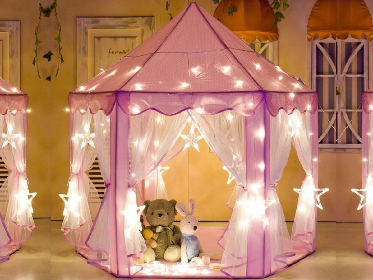 pink tent with lights and stuffed animals inside