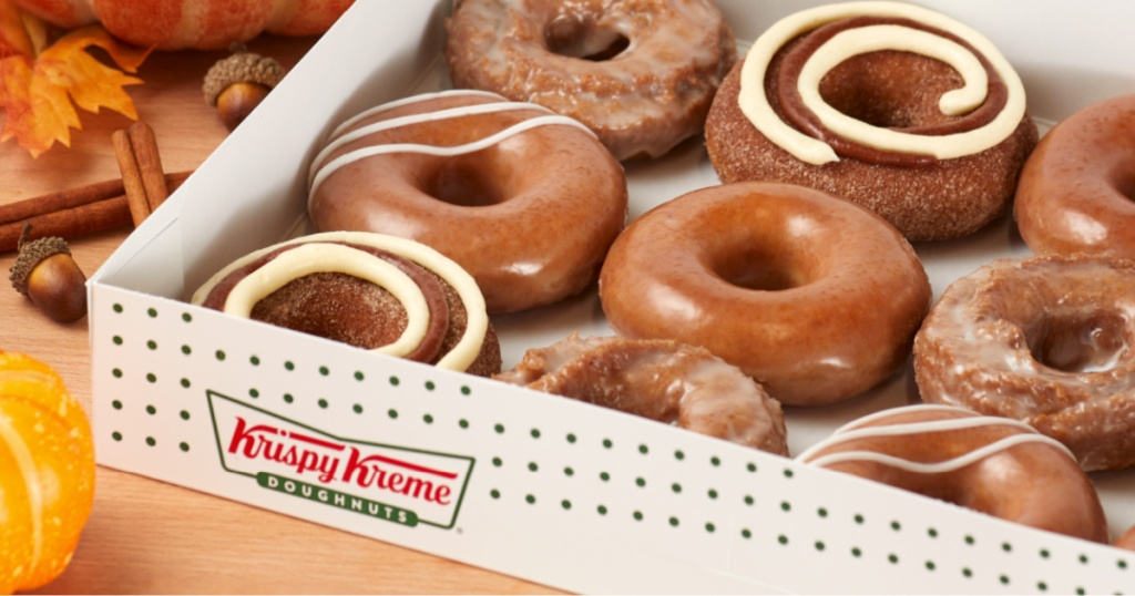 krispy kreme pumpkin spice donuts in box with fall decor