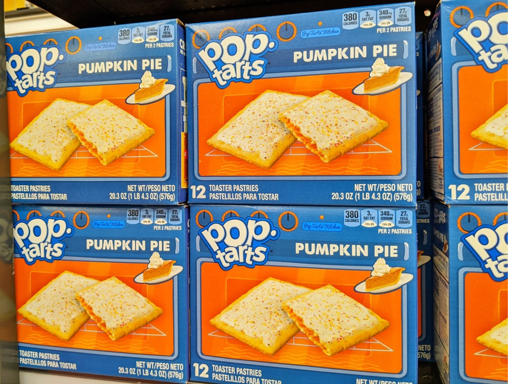 blue and orange boxes of pumpkin pie flavored pop-tarts on store display shelf