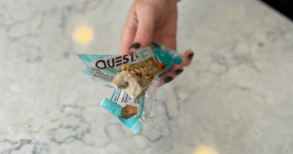 lady holding quest bars
