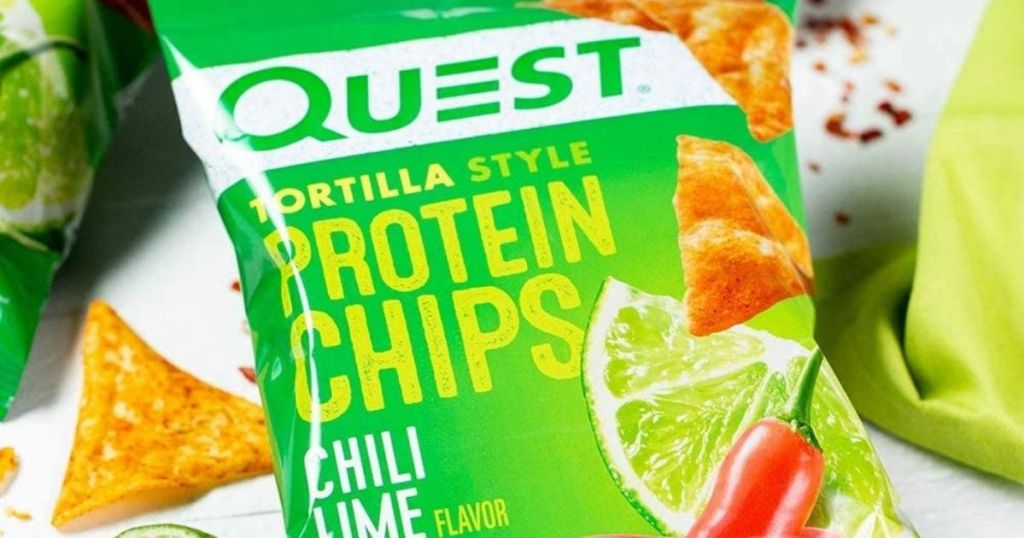 bag of Quest Protein chips with chips and limes around it