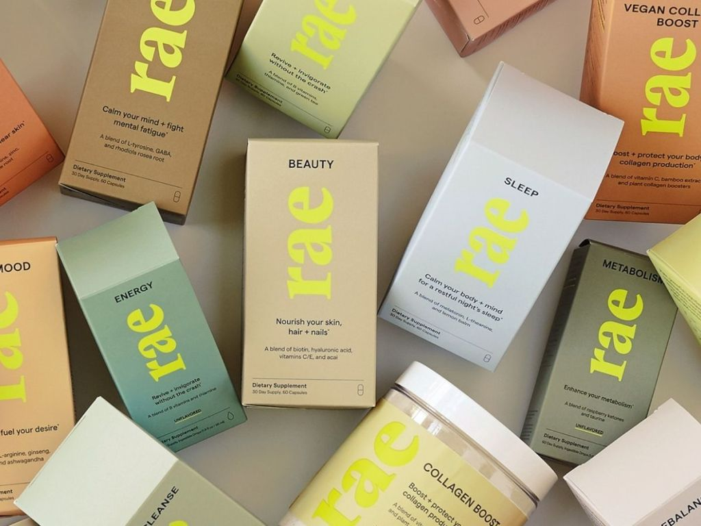Rae beauty products spread out on tan surface