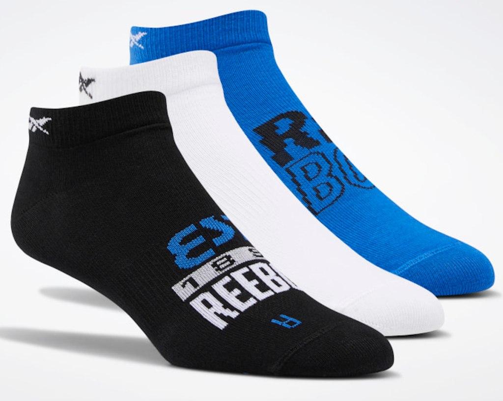 black, white, and blue reebok foundation invisible socks