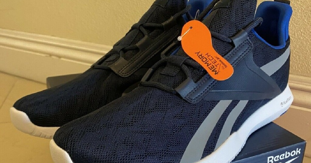 men's blue and gray sneaker on shoe box