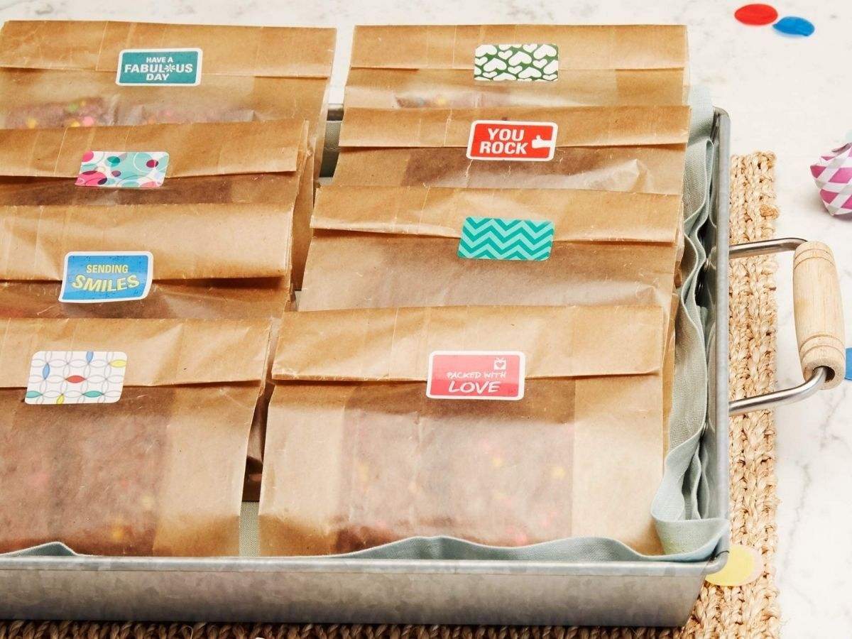 food wrapped in Reynolds Paper Bags and closed with stickers, resting in a tray with handle