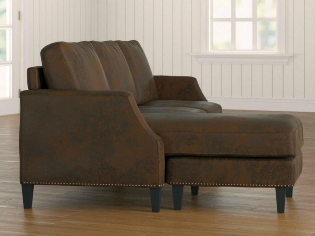 Laurel Foundry Modern Farmhouse sofa in a dark brown faux leather