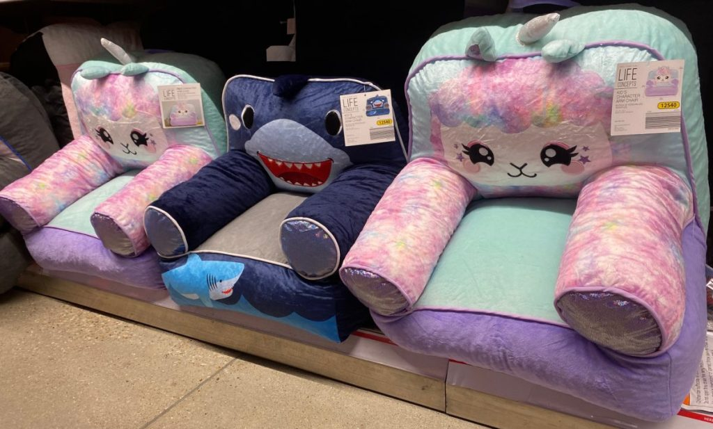 kids unicorn and shark armchairs on store shelf