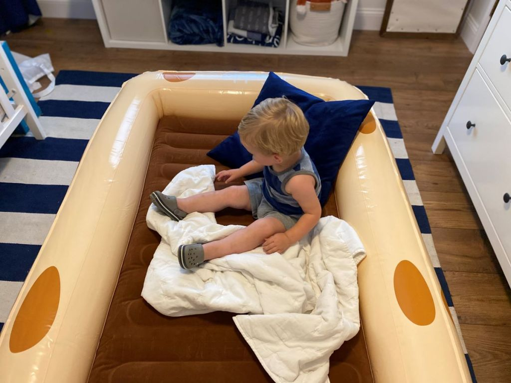 child sitting on an inflatable bed