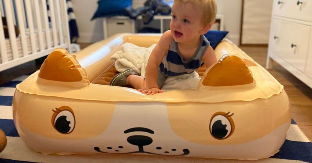 kid on an inflatable bed