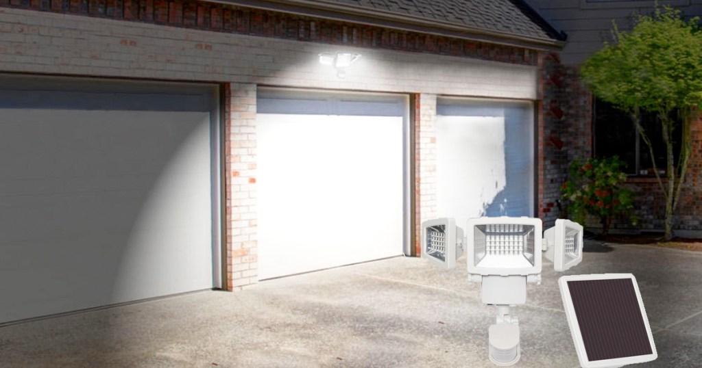 motion sensor security light shining above garage doors
