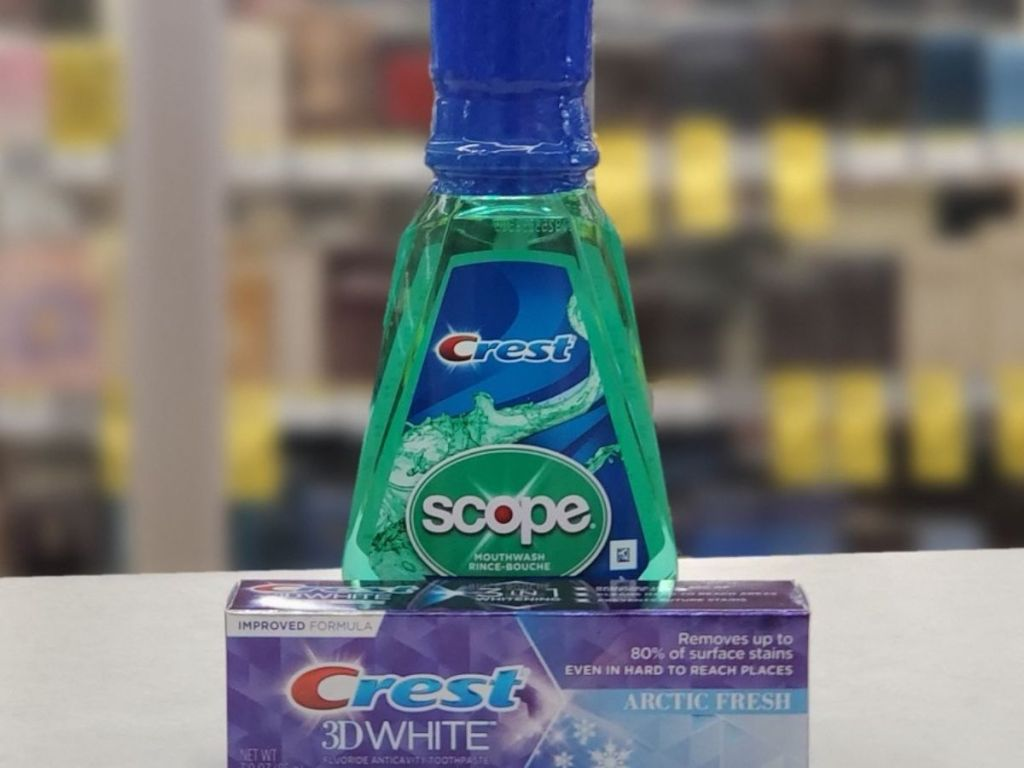 bottle of scope and box containing crest toothpaste