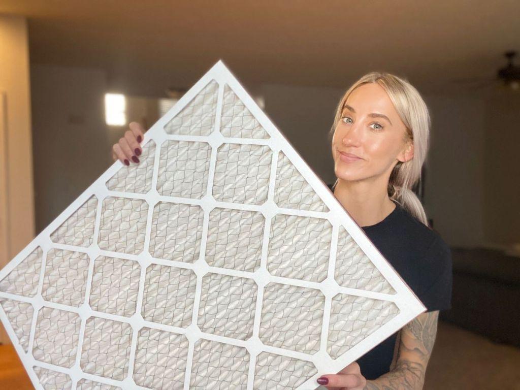 woman holding an air filter