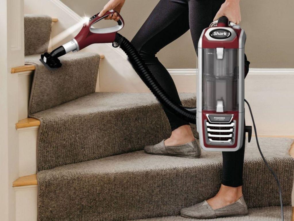 woman using shark duoclean vacuum