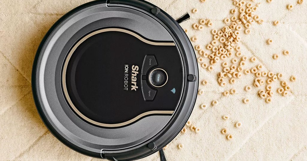 shark robotic vacuum cleaning up spilled cereal on carpet