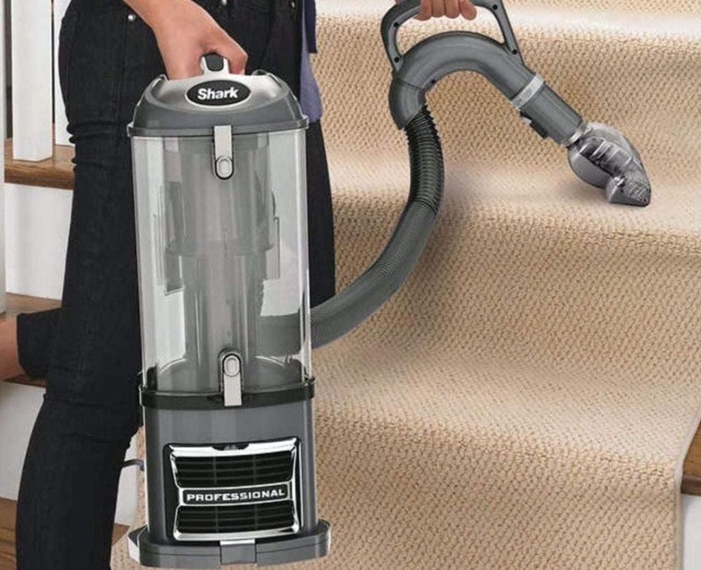 Shark Navigator Lift Away Vacuum being used on carpeted stairs