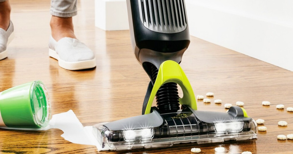 person using a shark vacmop on hardwood floors to clean up spilled milk and cereal