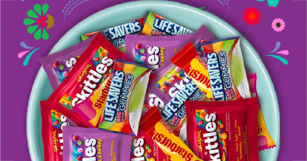 bowl of fun size candy and purple background