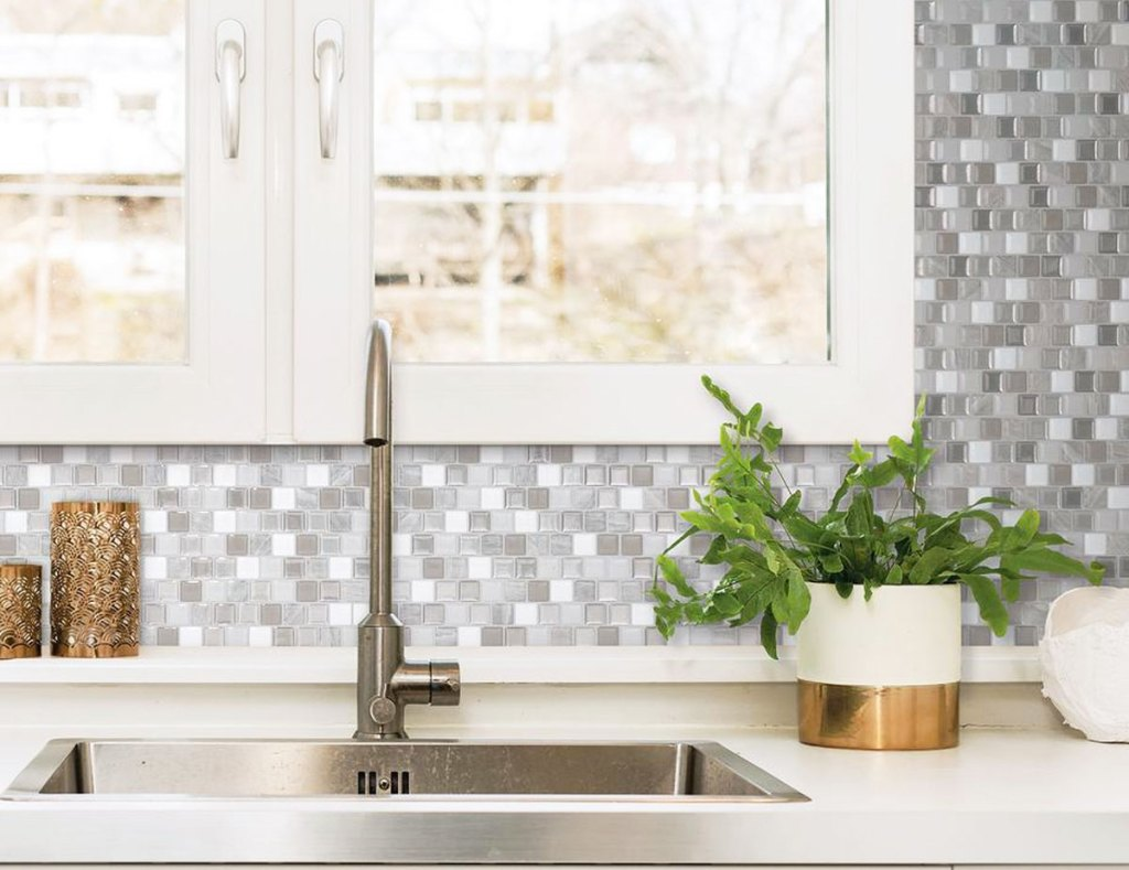 grey and white peel and stick mosaic backsplash on wall behind kitchen sink