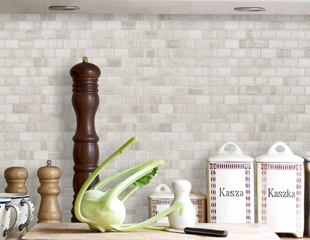 neutral colored peel and stick mosaic backsplash on wall in front of kitchen counter