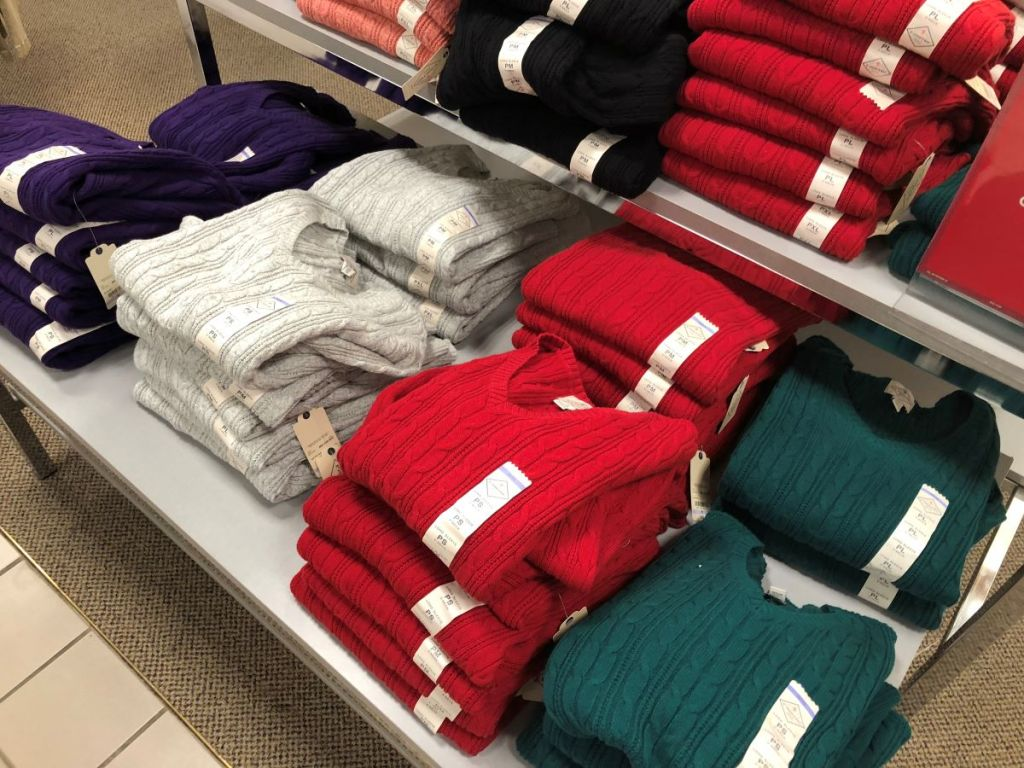 display of sweaters on a table