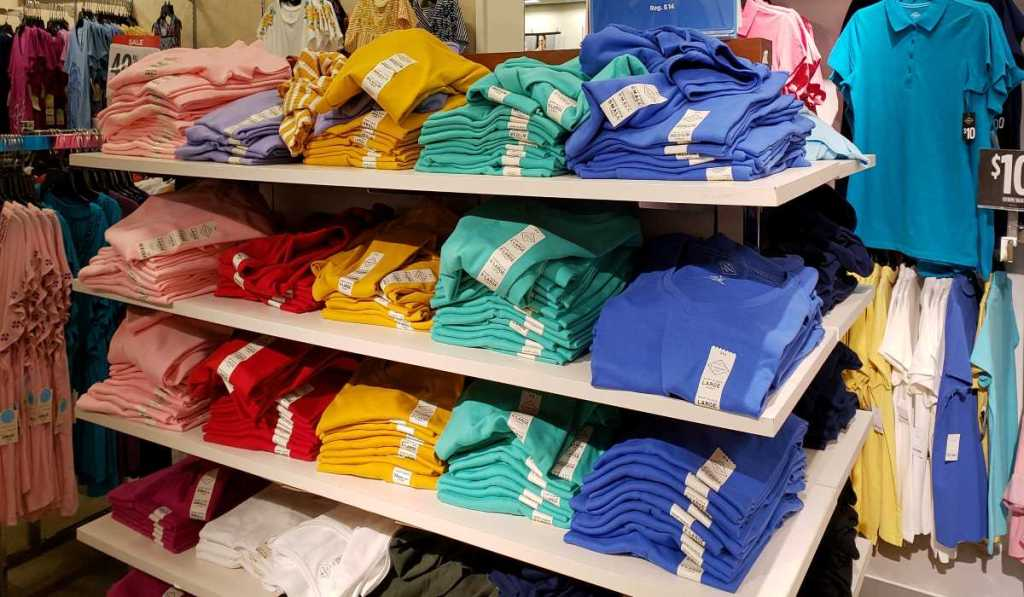 display of women's tee shirts on tables