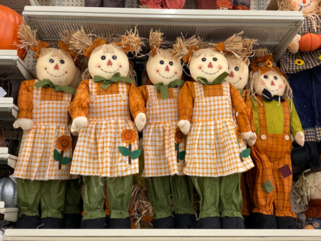 girls scarecrow decor hanging in store