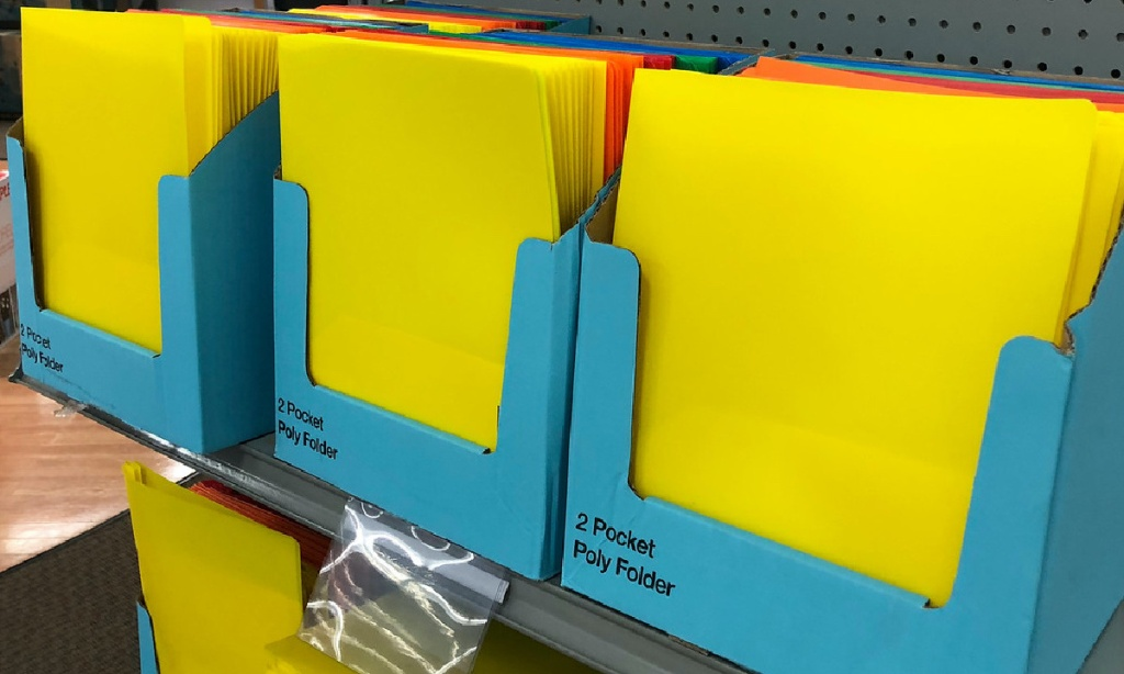 various colored folders on store shelf