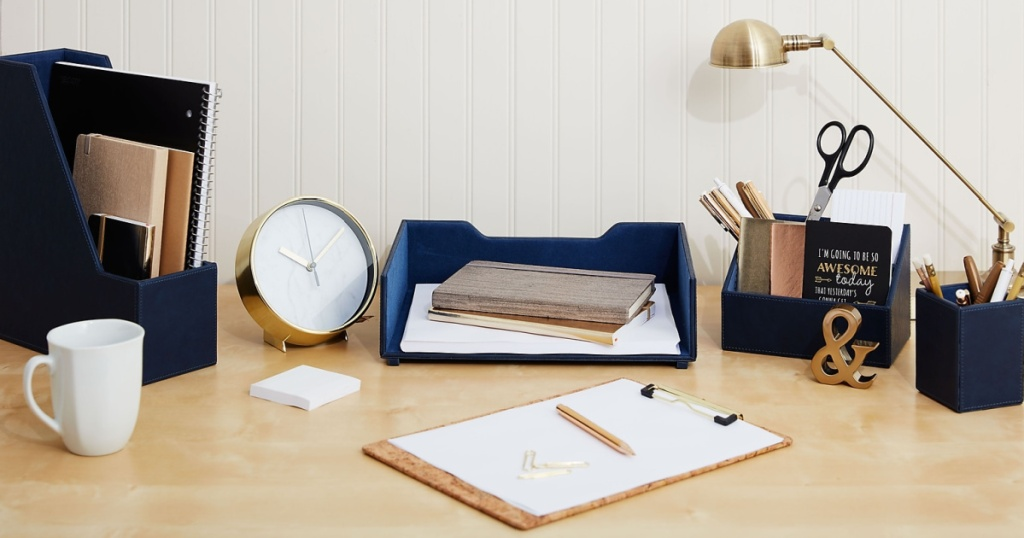 Staples Stackable Blue Letter Tray on desk with office supplies