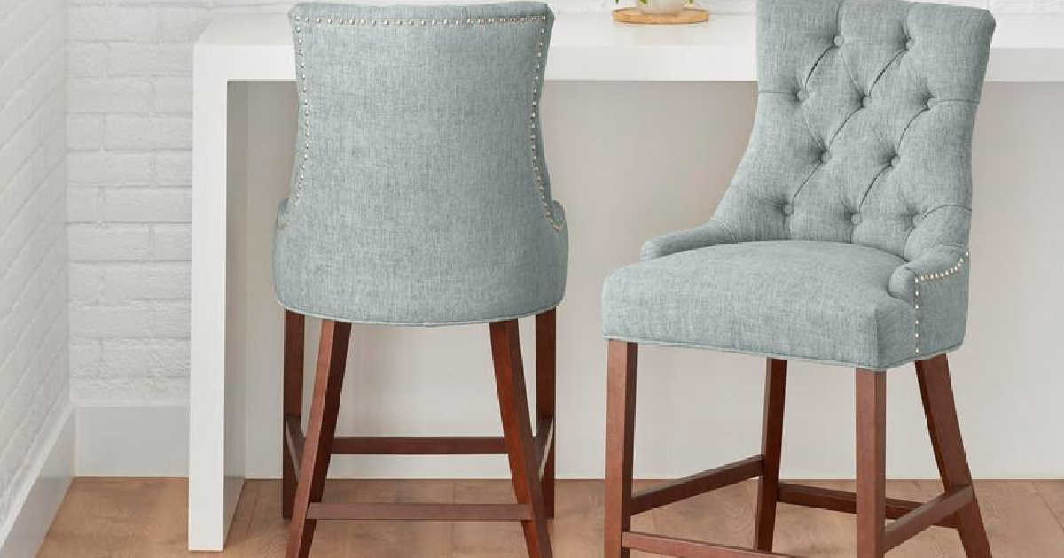 2 chairs with tuffed back and wooden legs in a soft aloe color