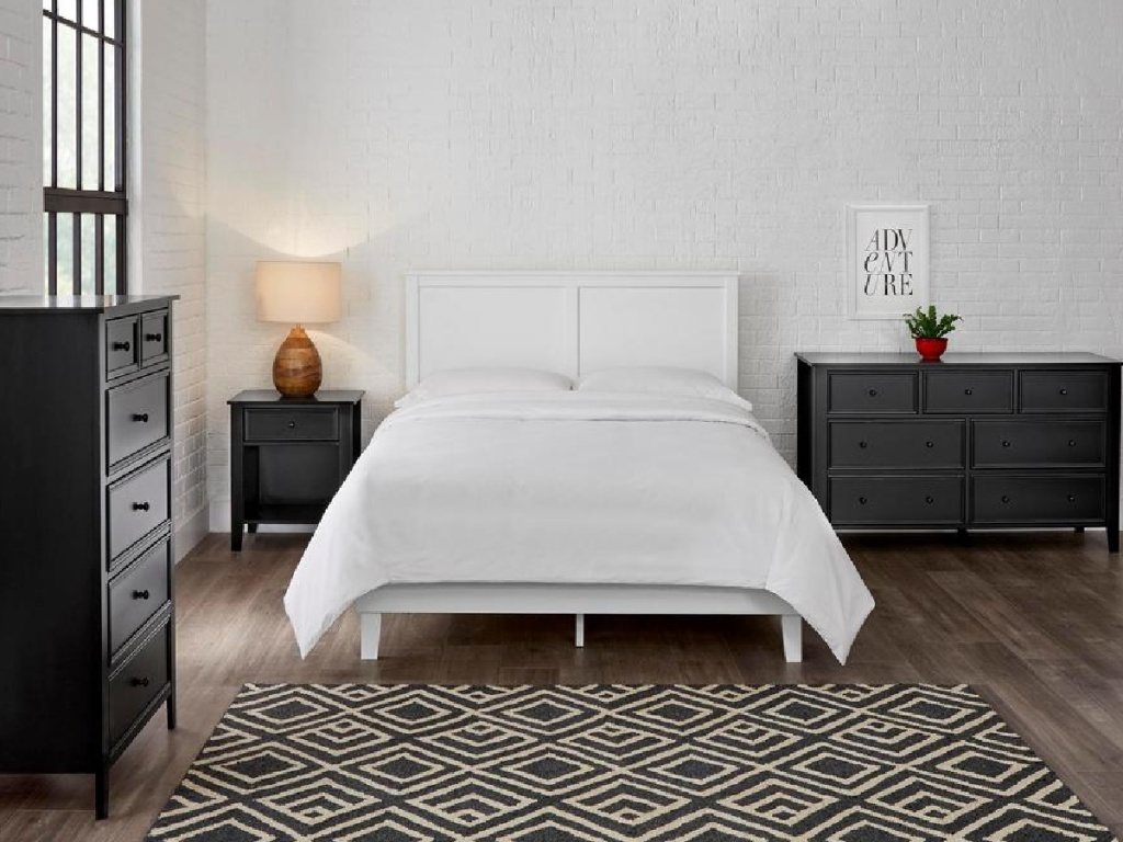 white platform bed with white bedding in bedroom