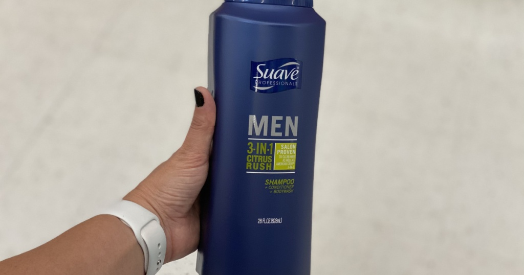 woman's hand holding a large bottle of suave men's body wash