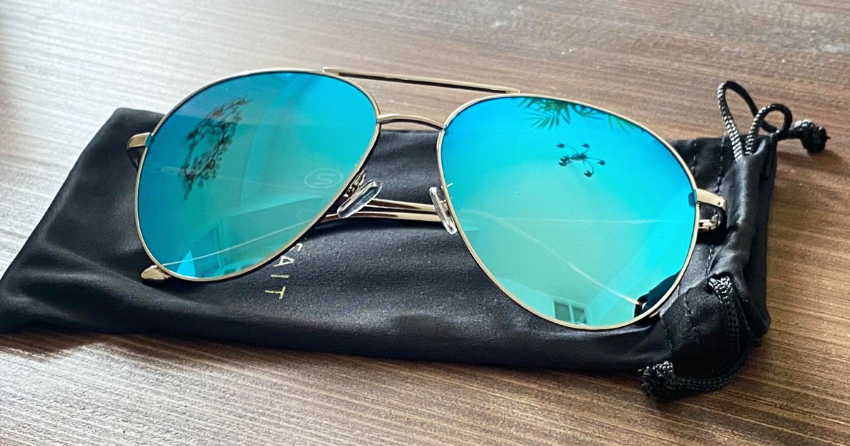 womens aviator sunglasses with blue mirrored lenses on black case