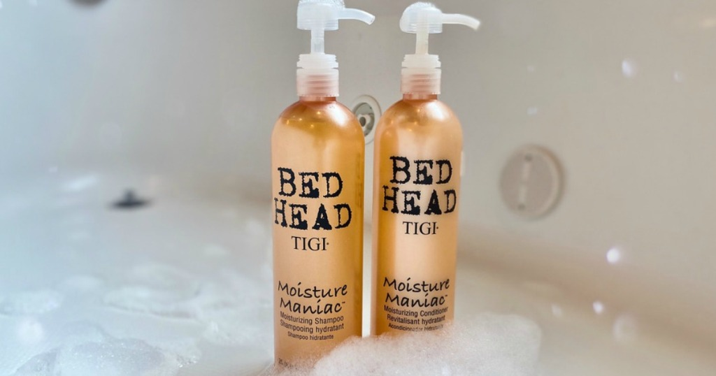 bed Head shampoo and conditioner bottles in a bathtub