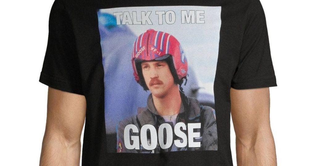 man wearing black talk to me goose t-shirt