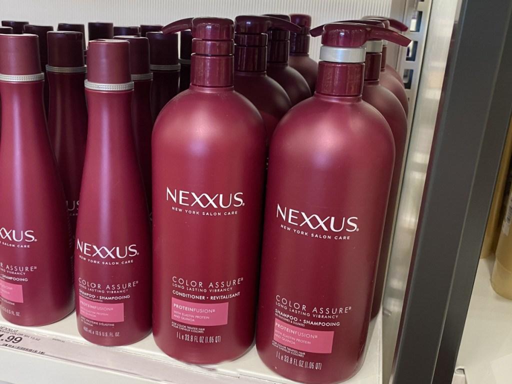 large bottles of Nexxus hair care sitting on a target store shelf
