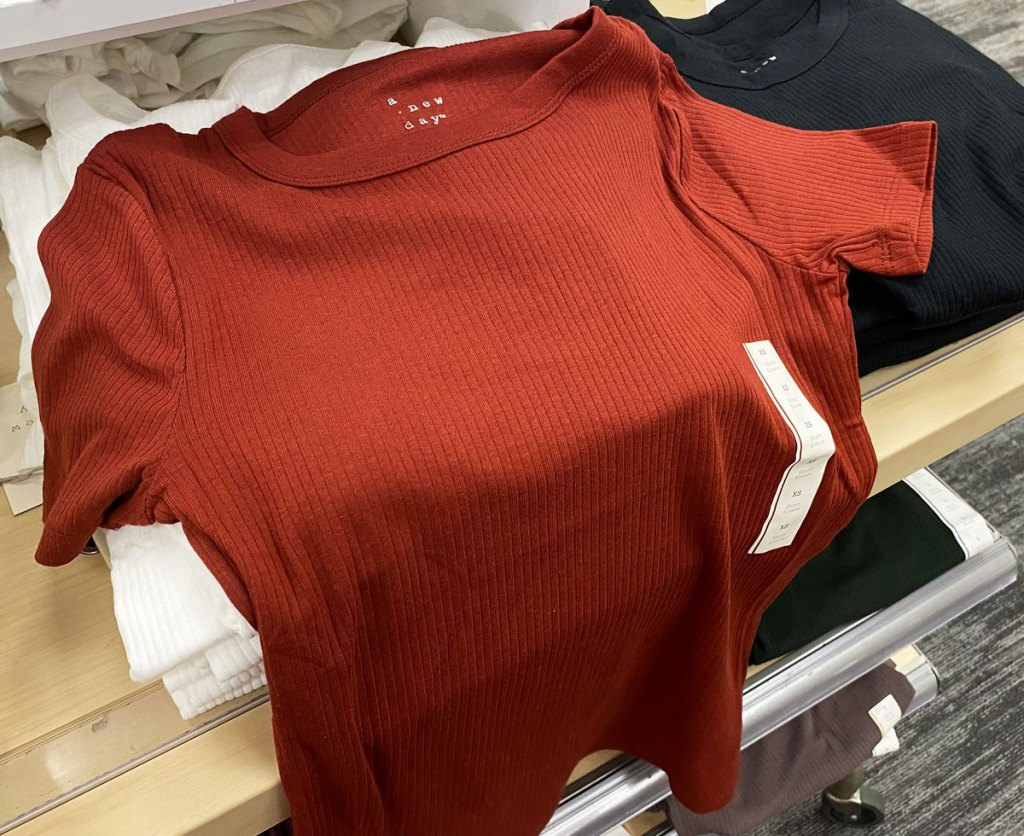 red women's ribbed t-shirt on a target store display table