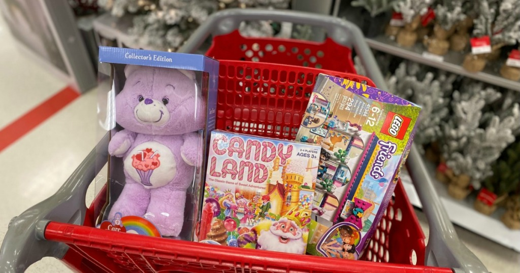 toys and games in Target cart near Christmas trees