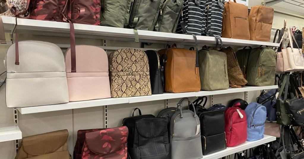 various handbags and backpacks on store shelves