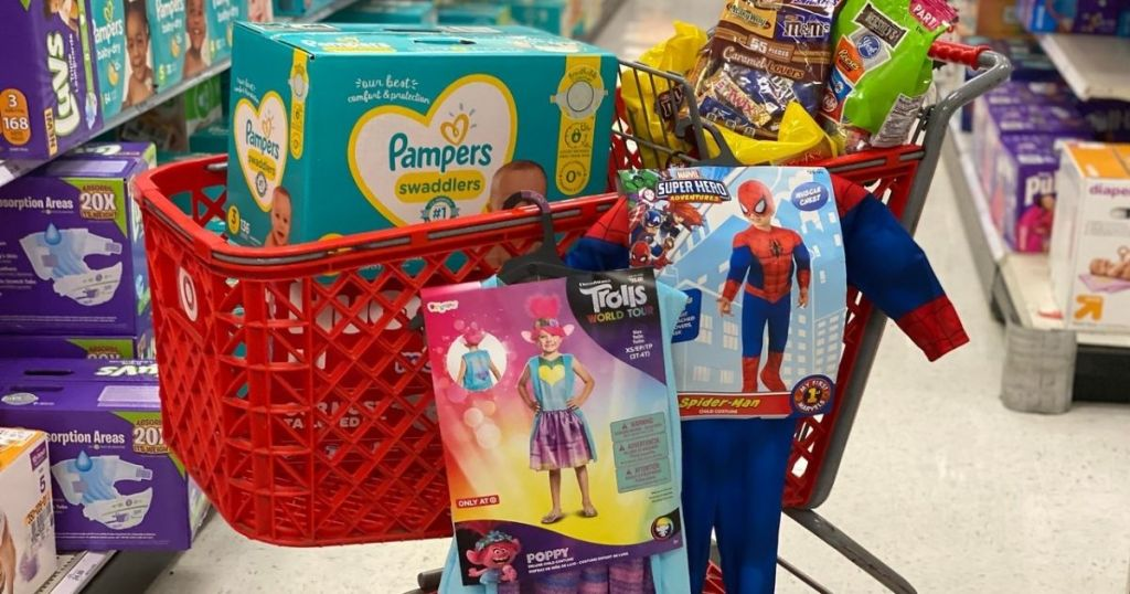 Target shopping cart with box of diapers, halloween candy, and halloween costumes