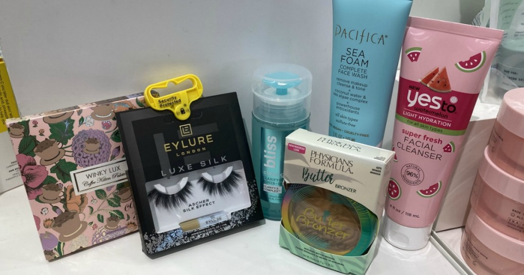 a variety of beauty products shown on counter at store