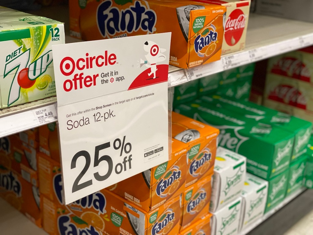 target circle offer sign with 12 packs of fanta, sprite, and 7 up in the background