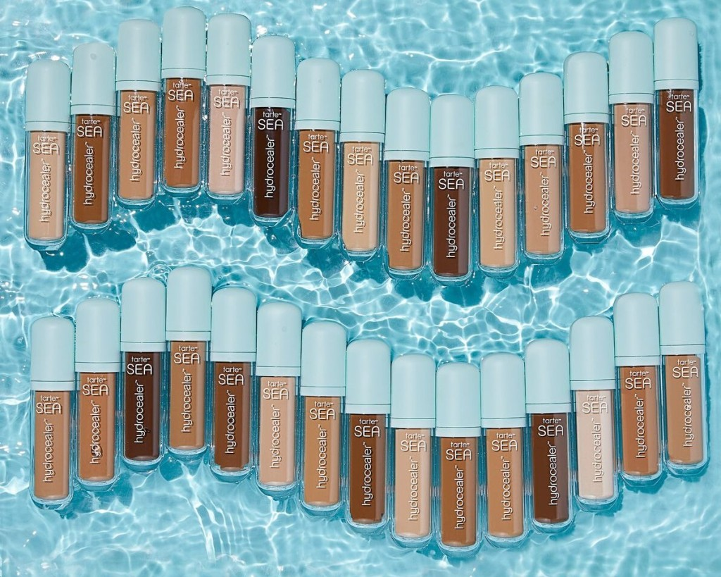 Tarte Hydrocealer Concealers in a line with water in the background