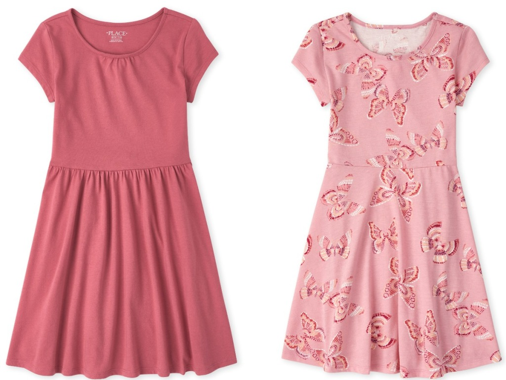 Two styles of girls summer dresses - plain pink and butterfly print