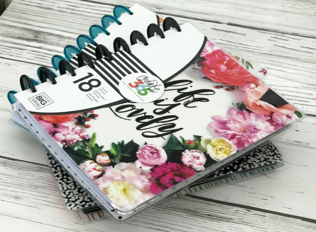 two spiral bound happy planner personal planners stacked on one another