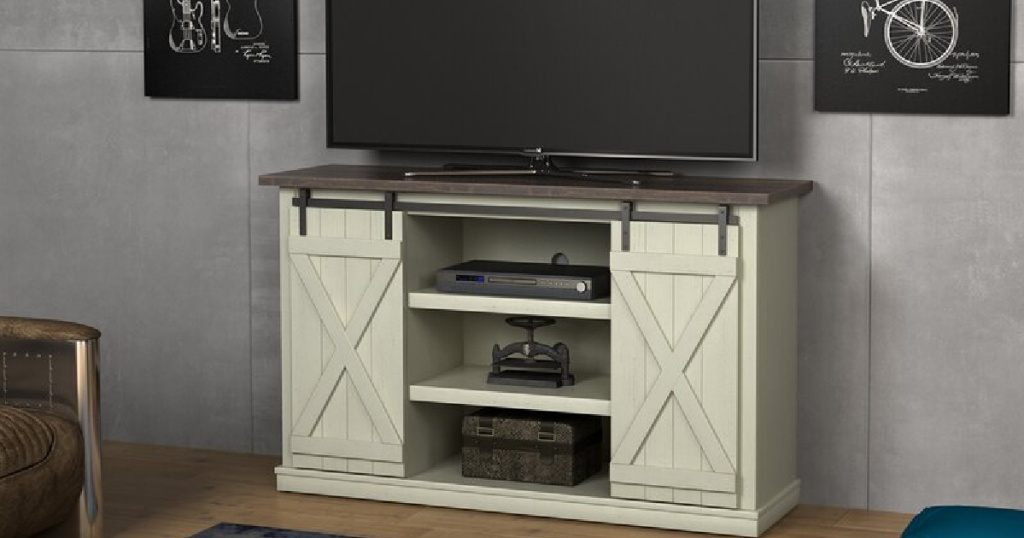 off white farmhouse-style tv stand in home