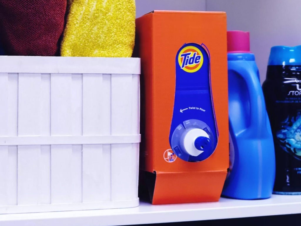 Tide HE Laundry Detergent 105oz Box sitting in a laundry room