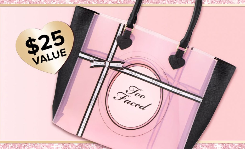 pink and black tote bag that says too faced on it
