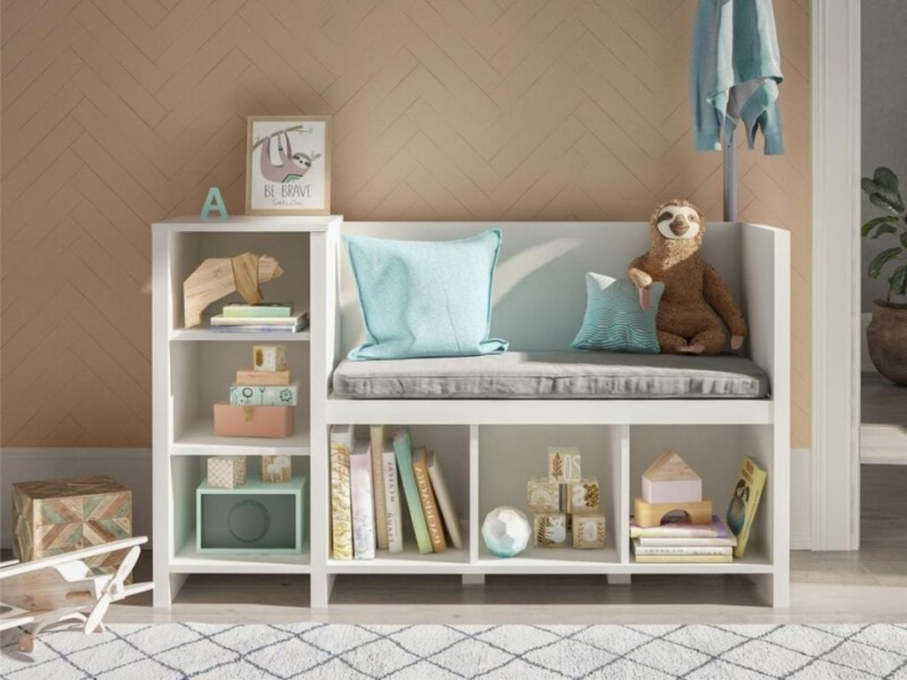 white kids storage bench filled with items