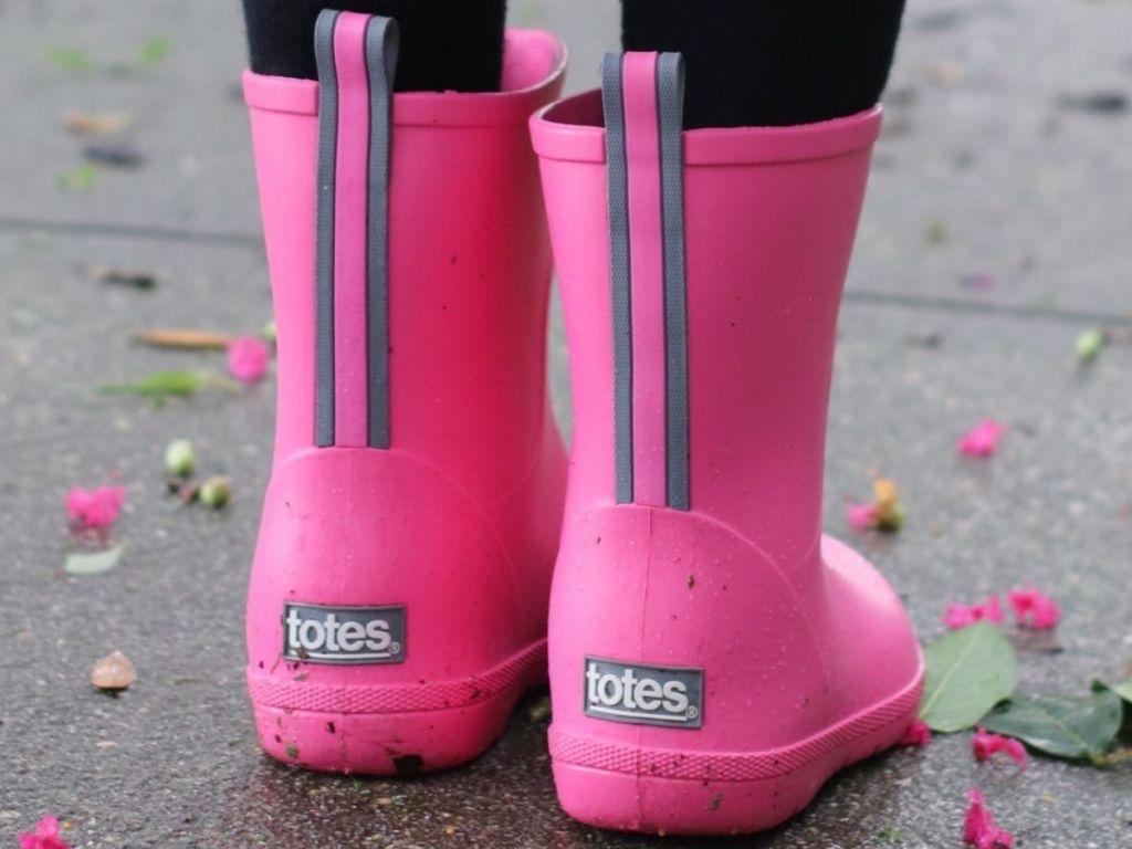 little girl wearing tall rain boots